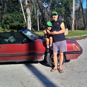 Don and his granddaughter enjoying the Mustang