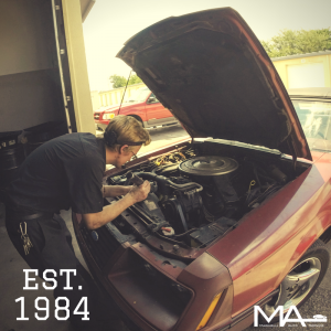 Andrew working on the 1984 Ford Mustang